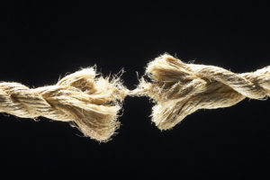 Rope - fraying-brown-fiber-rope-against-black-background-1